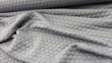 Soepele tricot met ingebreid nopje